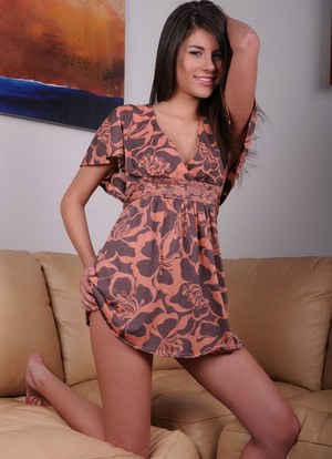 Cute smiley Shyla Jennings peel her short dress to flaunt her sweet naked ass