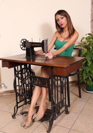 Sexy seamstress Daniela in tight dress flaunting naked feet on her machine