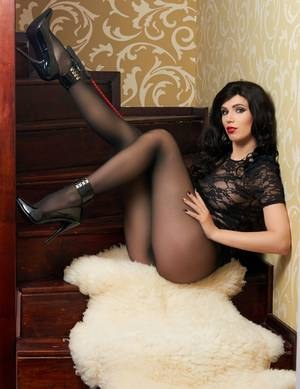 Sexy Nylon Queen in lace with crop poses displays ass in sheer black pantyhose