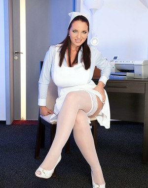 Hot MILF Joana Bliss releases her giant breasts from nursing uniform