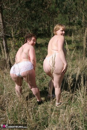 Older dykes on the heavy side of the scales bare their huge butts in a field