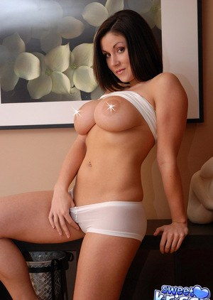 Horny Sweet Krissy undressing to rub and show ass in sheer white panties