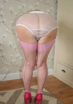 Sexy older Nylon Sue masturbating pussy in satin lingerie and sheer panties