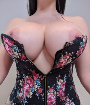 Dark haired beauty Kayla Kiss in tight bustier releases her massive big tits