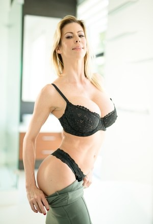Sexy blonde sheds black lace lingerie to free huge big tits in the bathroom