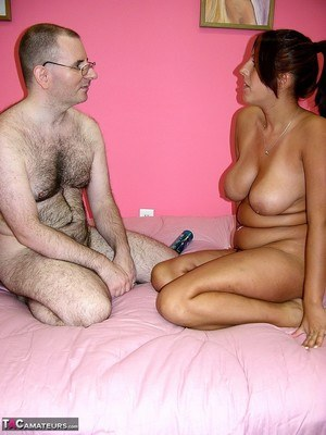 Busty mature BBW naked with her floppy tits hanging gives an oldman handjob