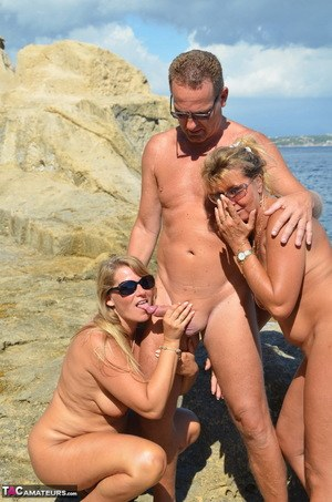 Two blonde women with saggy tits enjoy hot suck and fuck in beach threesome