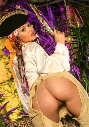 Solo model Lenka exposes her tits and ass in a pirate outfit