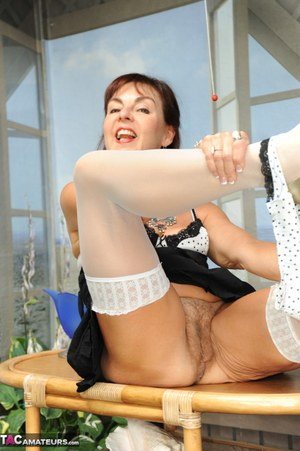 Beautiful nature woman Georgie shows her tits and twat wearing white stockings