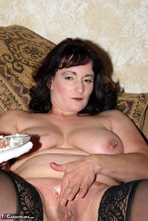 Fat amateur rubs cake into her pussy after stripping to sheer stockings