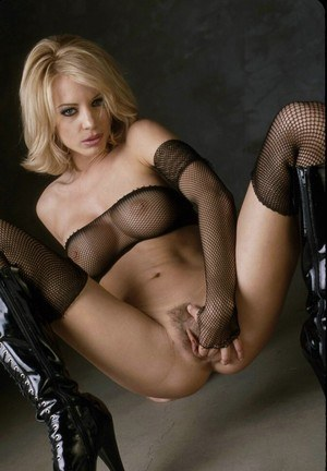 Hot blonde Nicoletta Blue toys her pussy in mesh attire and knee high boots
