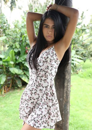 Sultry dark haired Latina Valery drops her sun dress to spread ass outdoors