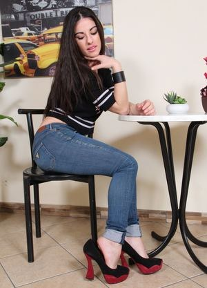 Fully clothed female frees her pretty white feet from her high heeled shoes