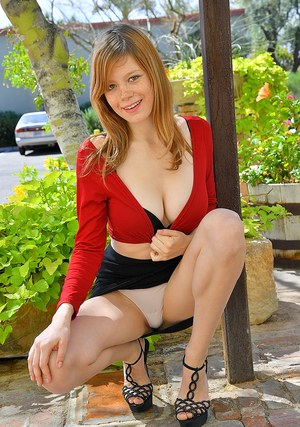 Freckled redhead hikes her black skirt over her white panties in public