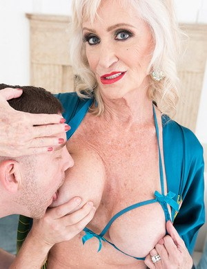 Sexy nan Leah LAmour pleasures a young man with a BJ and titty fuck