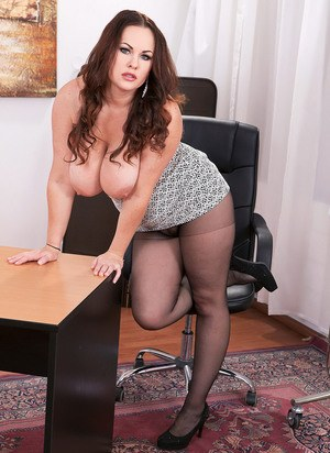 Overweight secretary Ellis Rose displays her big naturals in ripped hose