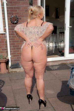 Busty mature wife Melody strips on the patio showing big tits & masturbating