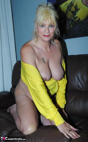 Hot mature Dimonty hikes short dress for nude upskirt  reveals her big tits