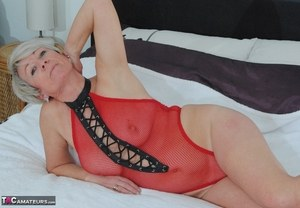Sexy mature Shazzy B flaunts her big boobs in in red sheer lingerie and boots