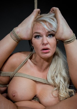 Busty blonde slave London River roped and chained for harsh BDSM torture