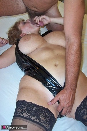 Busty Curvy Claire in latex sucks licks and strokes with massive melons bared