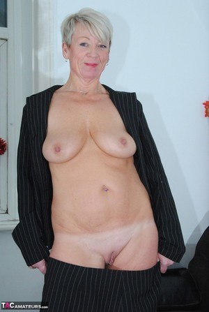 Old woman Dimonty confidently exposes her breasts and snatch