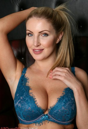 MILF beauty Georgie Lyall in blue lace lingerie spreading her hot pussy lips