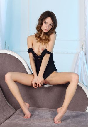 Skinny young Debora A sheds black lingerie to model her tiny ass on her knees