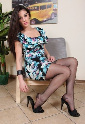 Hot brunette Bianca sheds high heels to show off sexy feet in black pantyhose