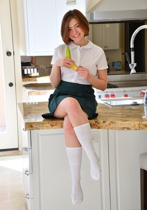 Natural redhead schoolgirl in knee socks toying with banana in the kitchen