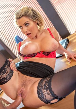 Busty office slut Sienna Day sucks off the boss wearing black stockings