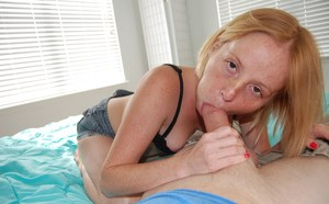 Freckled redhead Alyssa Hart uses her soft wet tongue while giving POV blowjob