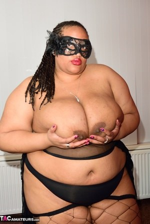 SSBBW wears a mask while unveiling her huge saggy tits and massive ass