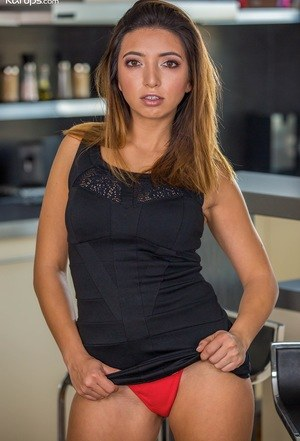 Charming Latina MILF Frida Sante loves playing with her twat in the kitchen