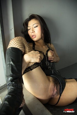 Caged hot Asian Chihiro Asai in leather  fishnet spreading wide behind bars