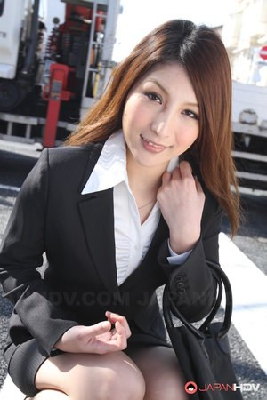 Hot redhead Japanese girl in suit poses to show her beautiful face