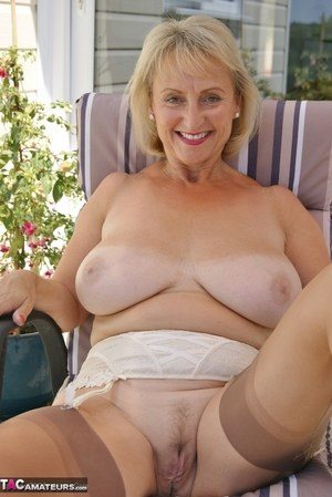 Busty blonde mature wife Sugarbabe squats topless outdoors to rub spread pussy