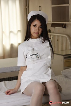 Horny Asian nurses strip their uniforms off and pose in sexy lingerie