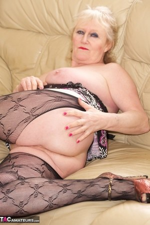 Lovely granny Claire Knight showing her perfect mature body in pantyhose