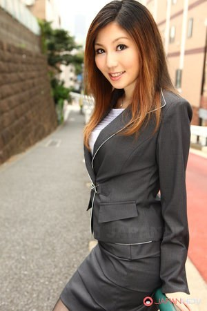 Attractive Japanese MILF Yuria Kanno posing in public in her sexy uniform