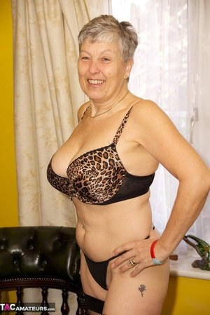 Horny old granny Savana shows off her hot body wearing sexy underwear  nylons