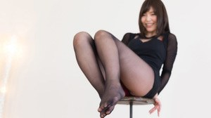 Sexy Japanese mom in black nylon stockings giving a virtual footjob