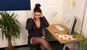 Lusty dark haired secretary Nicola Kiss craving some kinky office sex