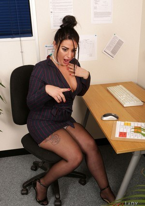 Curvylicious brunette in sexy uniform Nicola Kiss gets naughty at the office