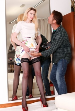 Long legged blonde strips to black stockings before giving a blowjob