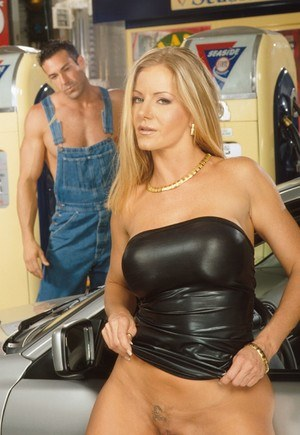 Big titted blonde Amber Michaels partakes in hard sex inside mechanic's garage