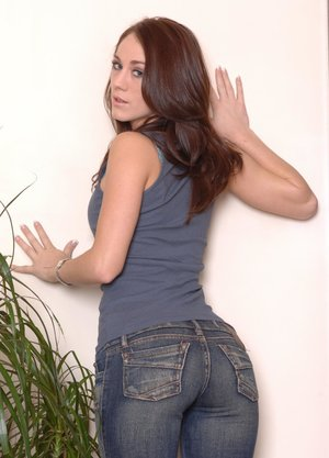 Brunette amateur Amber touts her nice ass in between spreading her pink pussy