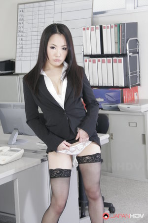 Japanese secretary Ai Mizushima models non nude at work in business attire