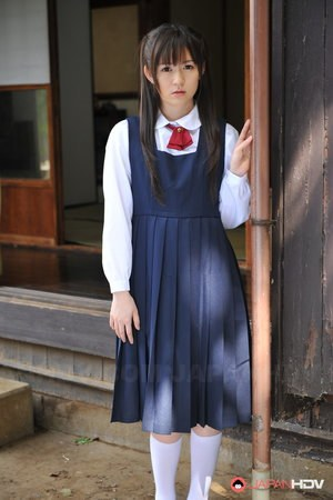 Charming Japanese babe posing in her cute school outfit in the garden
