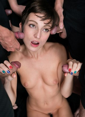 Short haired doll taking a brutal cum shower in a gangbang